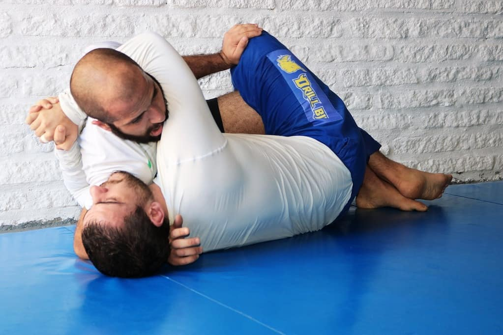Fighters training in BJJ rash guard shirts