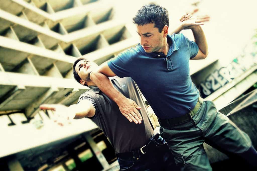 A martial art practitioner performs a self defense move